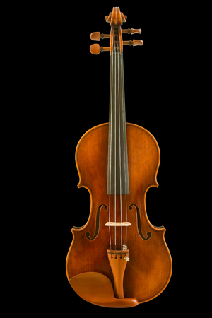 Front view of vintage violin isolated on black background