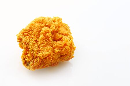 Fried chicken breast isolated on a white background.