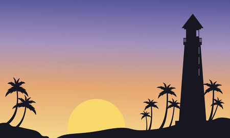 Silhouette of big lighthouse at sunset landscape