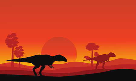 cretaceous: Silhouette of mapusaurus orange sky scenery collection stock