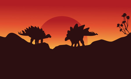 stegosaurus: Silhouette of two stegosaurus on the cliff scenery vector