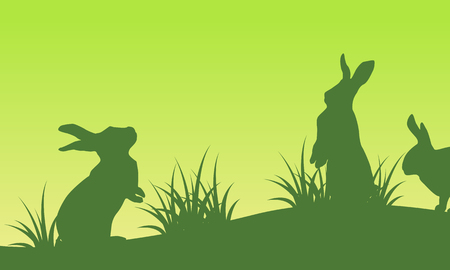 On green backgrounds easter bunny silhouettes