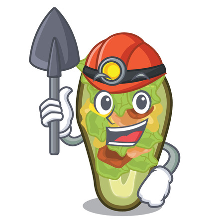 Miner stuffed avocado on a character board Banque d'images - 122045697