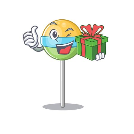 mascot round lollipop with holding gift character.Vector illustration Foto de archivo - 133341362