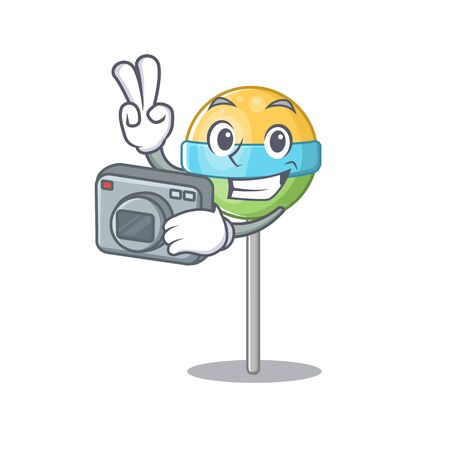 photographer a mascot round lollipop with character.Vector illustration Foto de archivo - 133341365