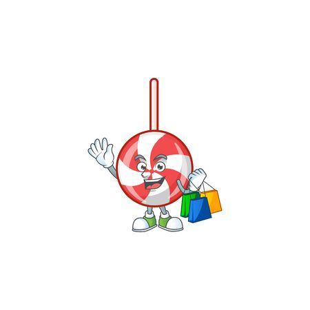 Cheerful striped peppermint candy cartoon character waving and holding Shopping bags. Vector illustration