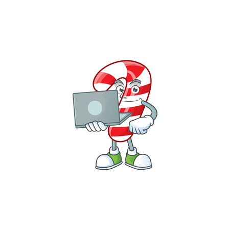 Happy smiling christmas candy cane cartoon character working with laptop. Vector illustration Ilustração