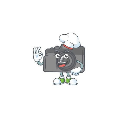 Digital camera cartoon character in a chef dress and white hat Foto de archivo - 140113262