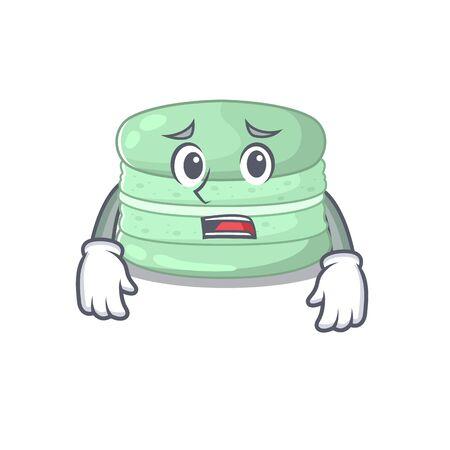 A picture of pistachio macaron having an afraid face