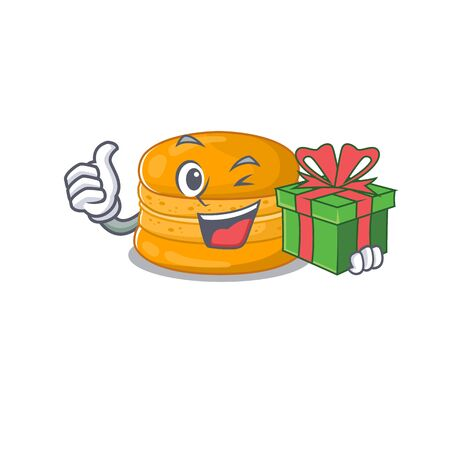 Smiley orange macaron cartoon character having a gift box. Vector illustration