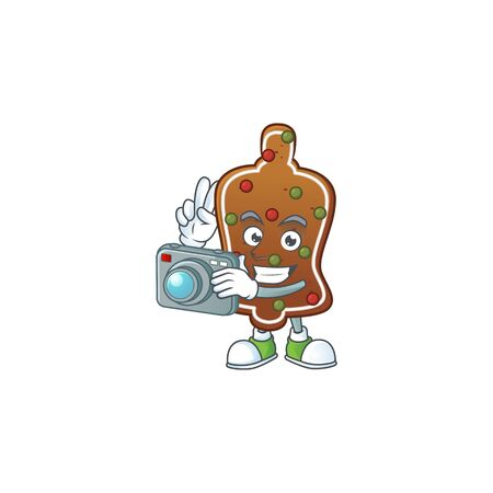 Gingerbread bell photographer mascot design concept using an expensive camera. Vector illustration
