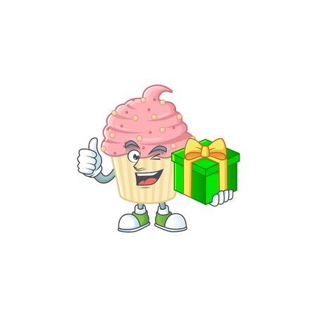 Smiley strawberry cupcake cartoon character holding a gift box. Vector illustration