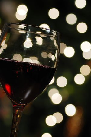 wine glass and christmas lights