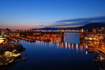 apartment market: Vancouvers historic Burrard Bridge at night