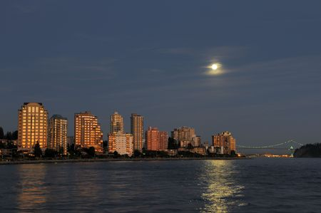 moon gate: north Vancouver waterfront buildings at moonrise