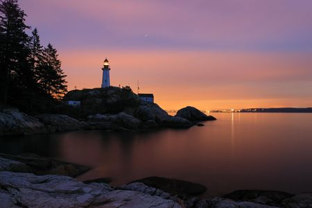 point atkinson lighthouse at night photo