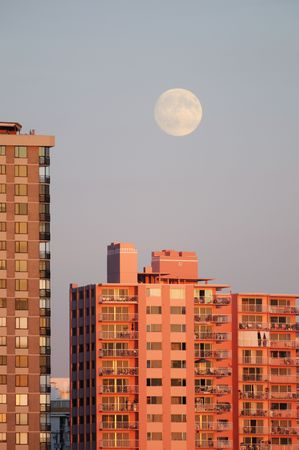 the apartment: moonrise and apartment buildings