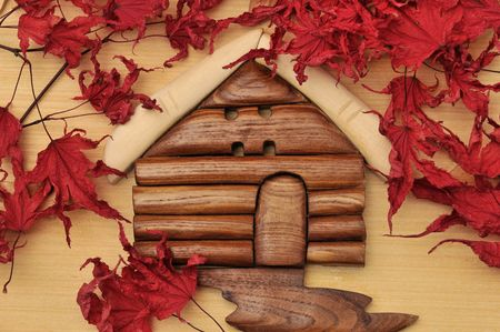 woodcraft: Woodcraft cabin house and dry maple leaves Stock Photo