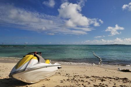 Jetski parked on white sand beach of bahamas Stock Photo