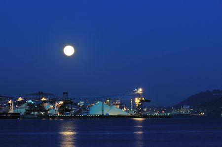 Industrial ship yard at Burrard inlet under moonlight photo