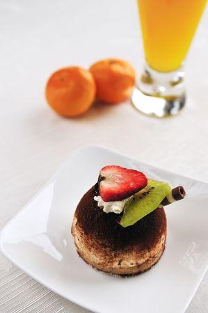 Tiramisu decorated with strawberry and kiwi fruit photo