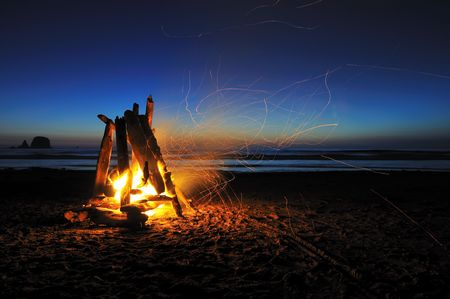 camping: campfire on shi shi beach, olympic national park