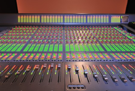 panel: audio post production mixing console with lights on Stock Photo