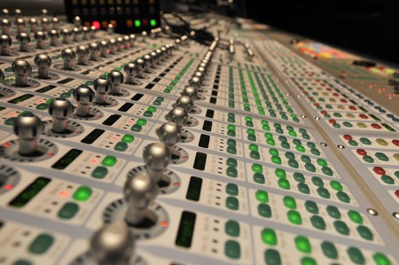 audio post production mixing console with lights on Stok Fotoğraf