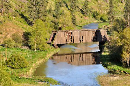 colfax: Harpole Railroad Covered Bridge with Reflection near Colfax