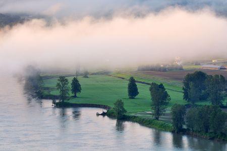 fraser river: Fraser river near Abbotsford at foggy sunrise, British Columbia, Canada Stock Photo