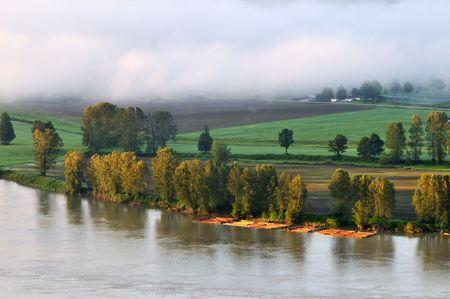 Fraser river near Abbotsford at foggy sunrise, British Columbia, Canada Stock Photo - 7196886