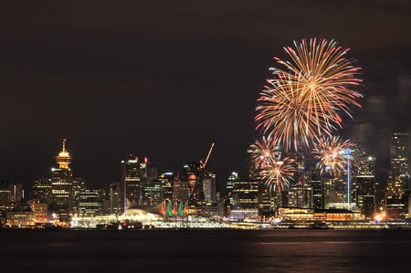 Downtown Vancouver with Canada Day Celebration fireworks  photo