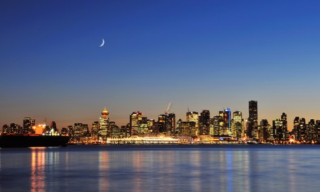 downtown vancouver night scene with crescent moon photo