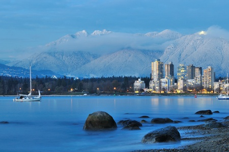 grouse: vancouver cityscape with grouse mountain in background  Stock Photo