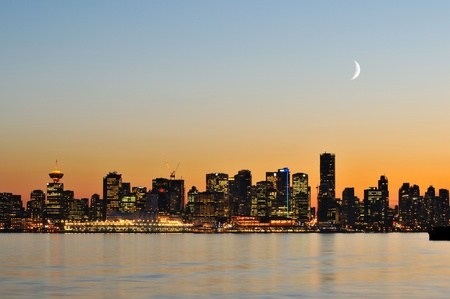 crescent: downtown vancouver night scene with crescent moon Stock Photo