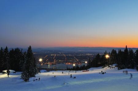 ski runs: Grouse Mountain Night Ski Runs overlooking Vancouver with sunset color
