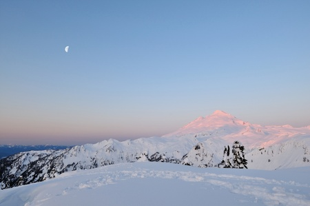 mt  baker: Mt Baker at sunrise and moonset, from Huntoon Point Stock Photo