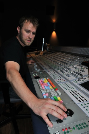 audio mixer: mixer working with the mixing console in sound studio Stock Photo