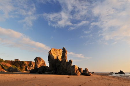 sunset with rock formations at bandon beach in Oregon,  pacific northwest usa  photo