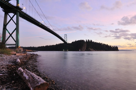west gate: Lions Gate Bridge at sunset with crescent moon
