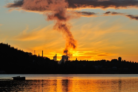 industrial: Oil refinery by the water at sunset