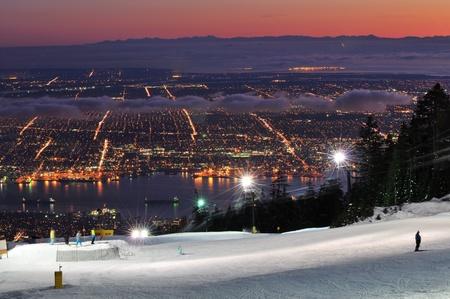 ski run: Grouse Mountain Night Ski Runs overlooking Vancouver with sunset color
