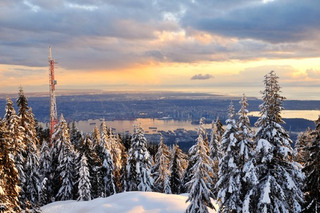 Grouse Mountain Winter Sunset with Downtown Vancouver in background