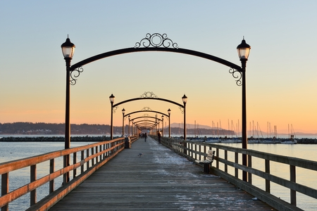rock arch: City of White Rock Pier at sunset, British Columbia Stock Photo