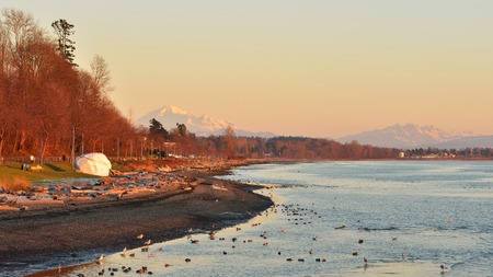 bc: The Rock of City of White Rock and Mt. Baker and Twin Sisters Mountain in Background
