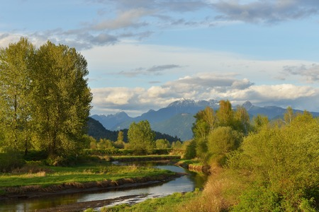 fraser river: Pitt River and Golden Ears Mountain at spring sunset, British Columbia Stock Photo