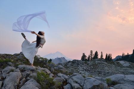 mt baker: A Girl dancing at sunset on Artist Point, Mt. Baker, Washington
