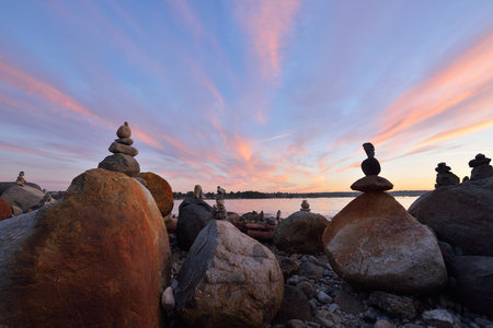balanced rocks: Balanced rock sculptures at English Bay during sunset, Vancouver, BC