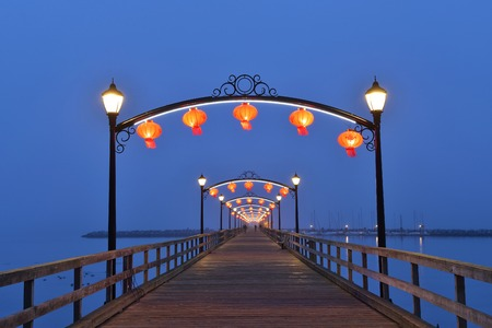 rock arch: Beautiful red lanterns light-up the White Rock Pier to celebrate the Chinese Moon Festival Stock Photo
