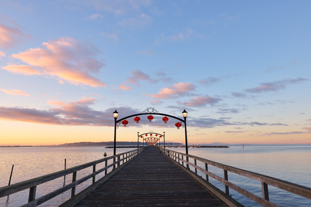lightup: Beautiful red lanterns light-up the White Rock Pier to celebrate the Chinese Moon Festival Stock Photo